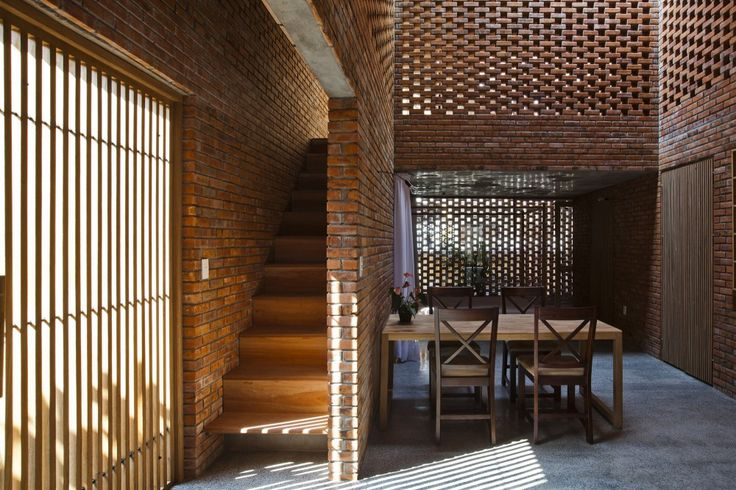 Brilliant finishing of exposed concrete and brick.  Termitary House / Tropical Space