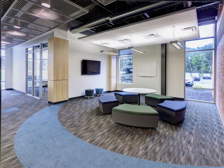 The Basics Collection with bright pops of In Color create a colorful workspace for Jadak Technologies. Designed by Design Specialists, Inc. #floorcovering #interiordesign #officedesign #modularcarpet