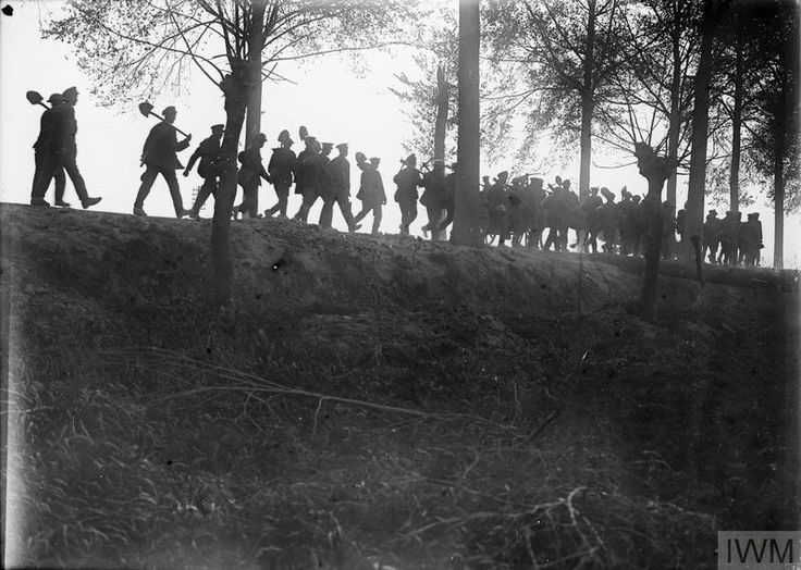 WWI, 6 Sept 1917; A Labour Battalion returning in the evening after the day's work consolidating newly won ground, near Ypres. Battle of Passchendaele. ©IWM Q 2992