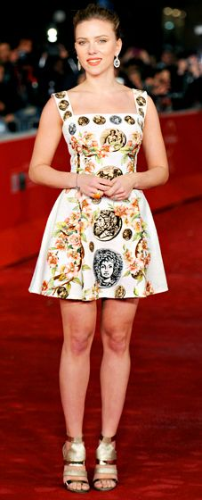 Scarlett Johansson in a sleeveless white Dolce & Gabbana dress with intricate detailing