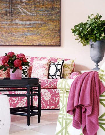 The living room's happy colors — light pink, chartreuse, magenta, black and white — are repeated in the dining area.