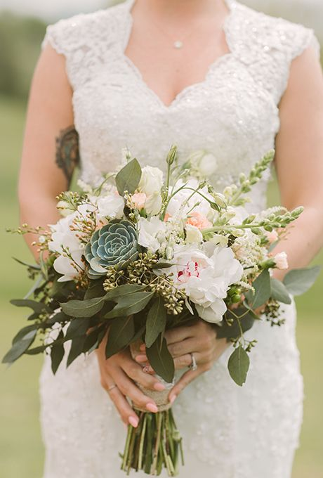Brides.com: . Florist Elaine Pisarcik gave this bouquet of peonies and stock flowers a heatproof upgrade with the addition of green succulents.