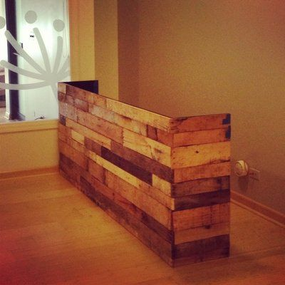 Recycled wooden pallets transformed into a reception desk