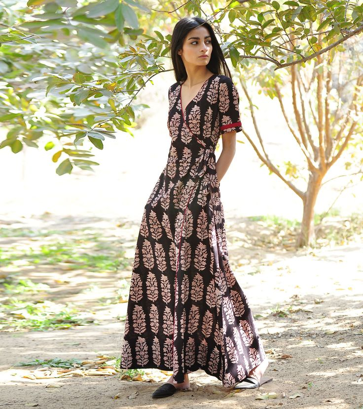 Make an entrance in this ethereally draped black block printed cotton gown.  The design features short sleeves, side pockets, an beautiful flare, ...