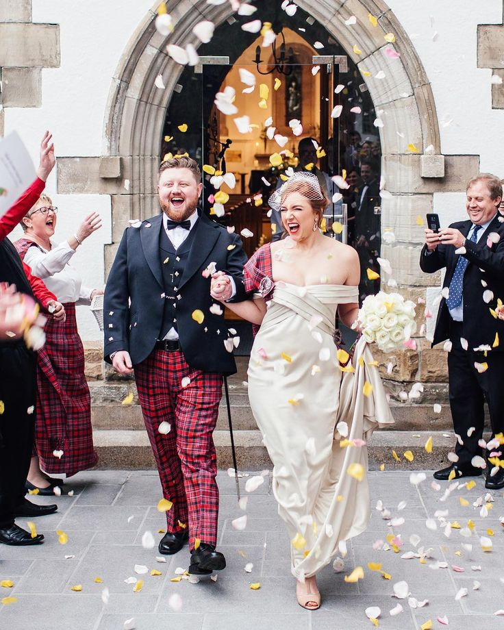 She walked down the aisle to the sound of Highland Cathedral Bagpipes. The women pinned the Family Tartan and welcomed her to their clan. In a mix of Old Hollywood Glam meets Tartan Tradition  I just can't get enough of this Scottish Wedding.