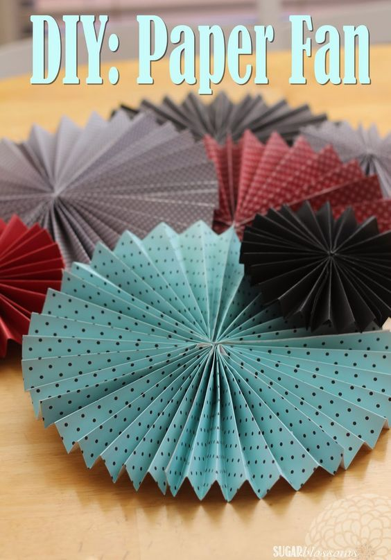 Sugar Blossoms: DIY: Paper Fans Here's what you'll need to make 1 large fan: 3- 12x12 pieces of paper (same design/print) glue gun....fishing line (optional; for hanging from the ceiling):