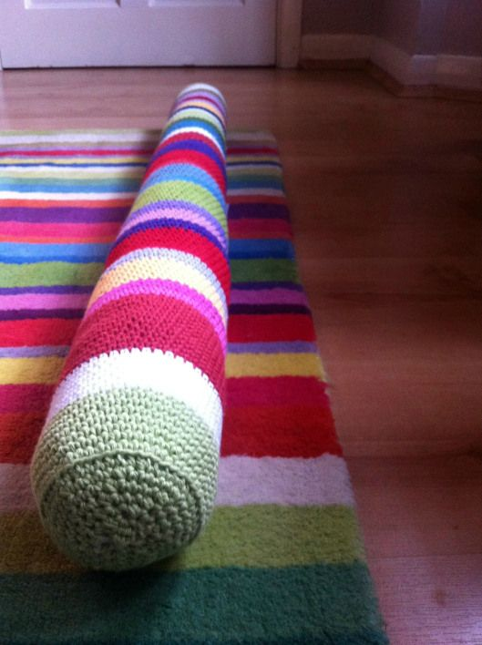 The Striped Draft Stopper by crochetime using this pattern http://www.lionbrand.com/patterns/90693AD.html