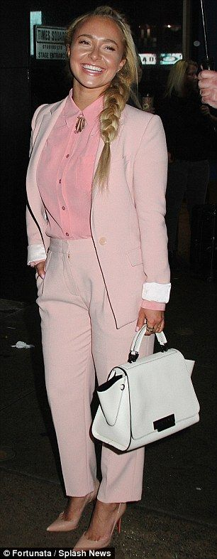 Pretty in pink: The new mother stunned in a chic pantsuit four months after giving birth...