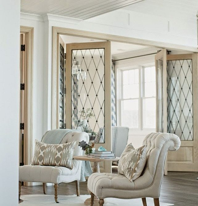 Tour this beautiful San Clemente, California beach house. The above photo shows the lovely bi-fold doors that separate the private dining area from the rest of the house. ~