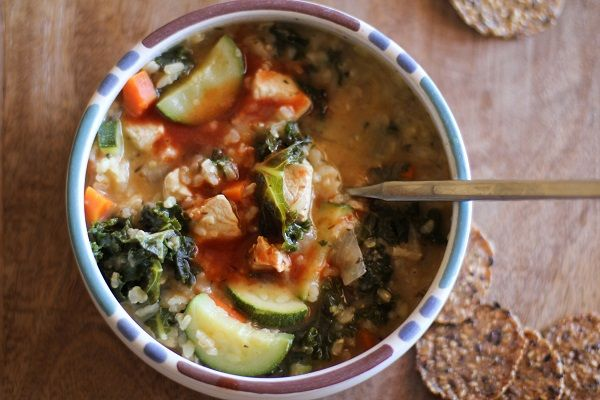 Hearty chicken soup with rice and kale. Because colds don't care if it's July or January.