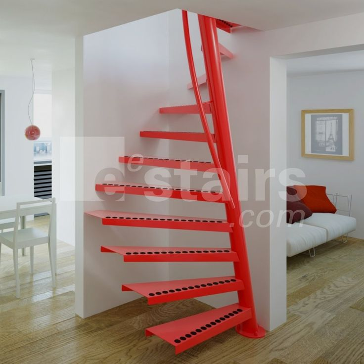 A red space-saving staircase on a wooden floor, with a white sleeper sofa and a black radiator.