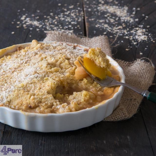 apple and peach oatmeal crumble. A simple recipe for a delicious dessert served with ice cream. Ideal for using left over canned peaches.