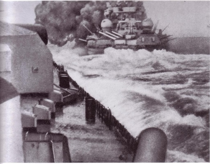 German battleship Gneisenau firing on the carrier HMS Glorious, sunk in June 1940 whilst covering the evacuation of British and French forces from Norway. She is photographed from her sister Scharnhorst: they were sometimes categorised by the British as battlecruisers.