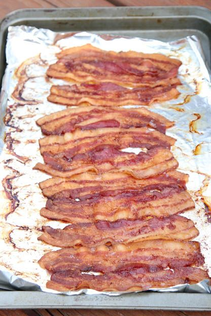 How to Cook Bacon in the Oven - (Yet another method. This one uses foil under the bacon, and says to make sure to use a rimmed pan so the grease doesn't seep into  the oven.)