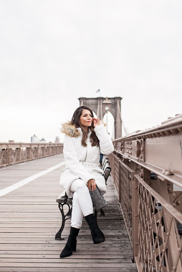 Holiday looks with INC International Concepts available at Macy's. Faux fur hooded coat, white jeans, black booties, jeweled clutch
