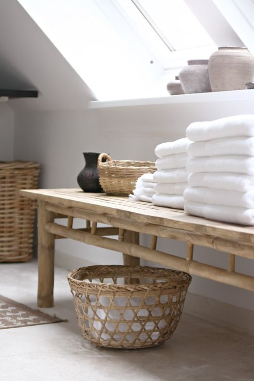 Baskets, bench, pots, white fluffy towels; great for under-eaves bathroom
