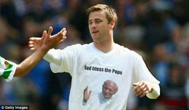 Celtic goalkeeper Artur Boruc displays a John Paul II T-shirt after a Celtic v Rangers game in 2008. © Getty