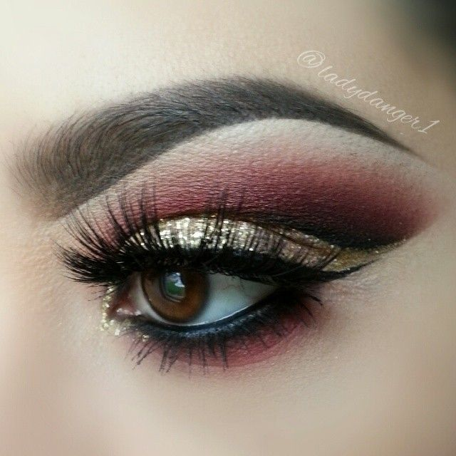 Burgundy and gold glitter makeup with eye winged liner #eyes #eye #makeup #eyeshadow #glitter #bold #dramatic