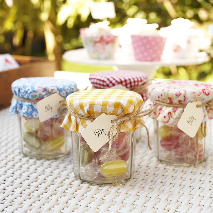 Glam up old Jam Jars With Pretty Fabric Offcuts.