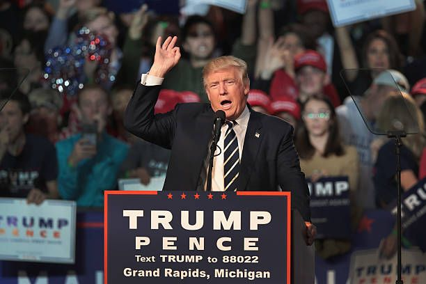 Republican presidential nominee Donald Trump addresses supporters during a campaign rally on November 8 2016 in Grand Rapids Michigan With less than...