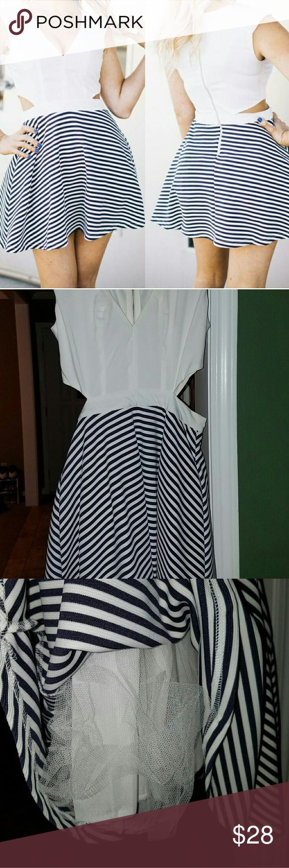Ivory and Navy Striped Dress Gorgeous dress with v neck ivory top, cut outs on the sides and Navy Striped bottom that flares- tutu material underneath provides an umph. Stunning! Only worn once to wedding, received many compliments. Perfect condition. Dresses Wedding