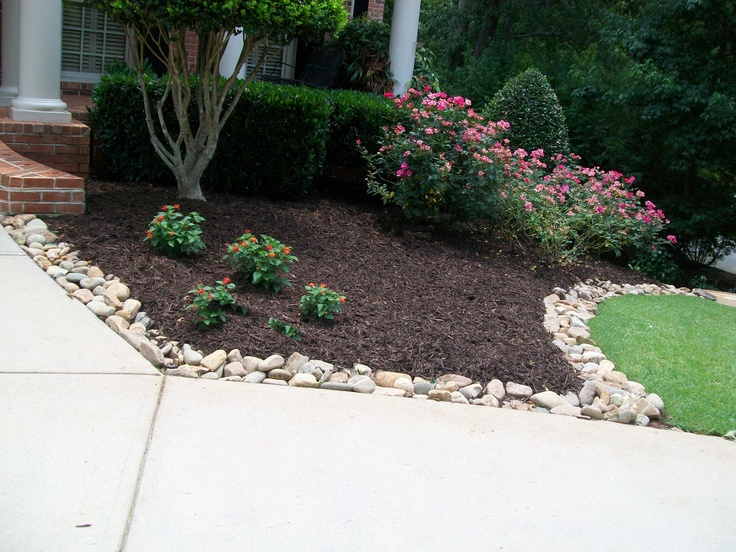 Smooth rock border installed 06 2012 photo by jan pierce for Smooth landscaping rocks