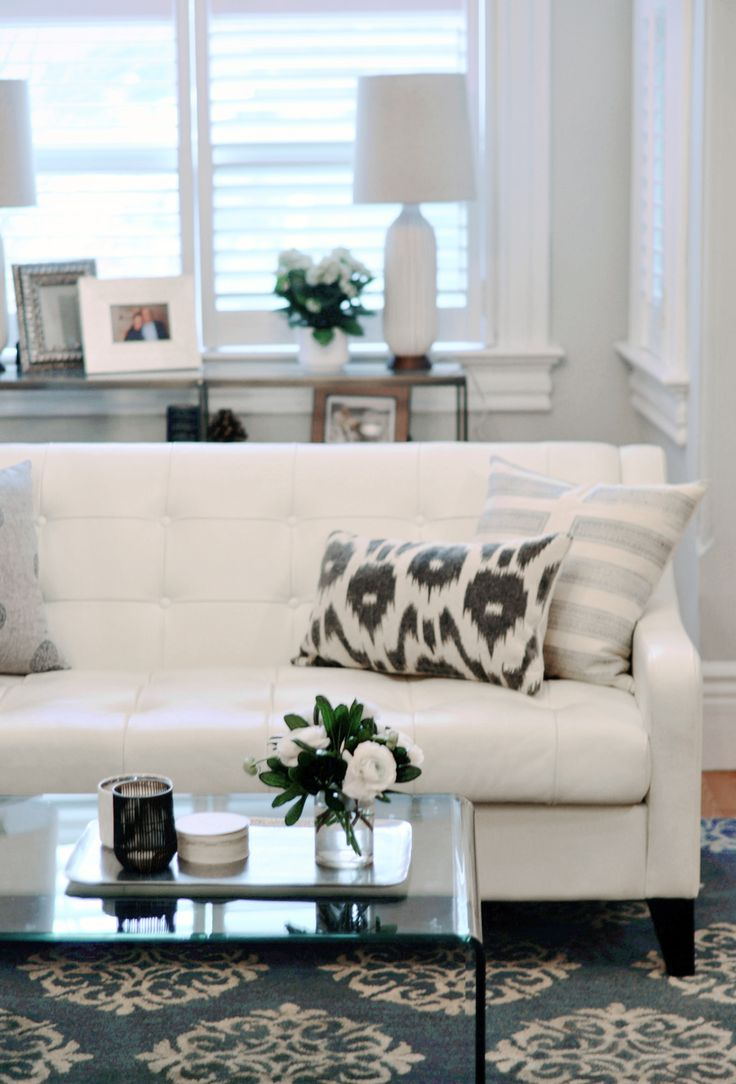 I love the white couch! All the light colors in this room makes it look really light and airy! I also love the patterned rug!
