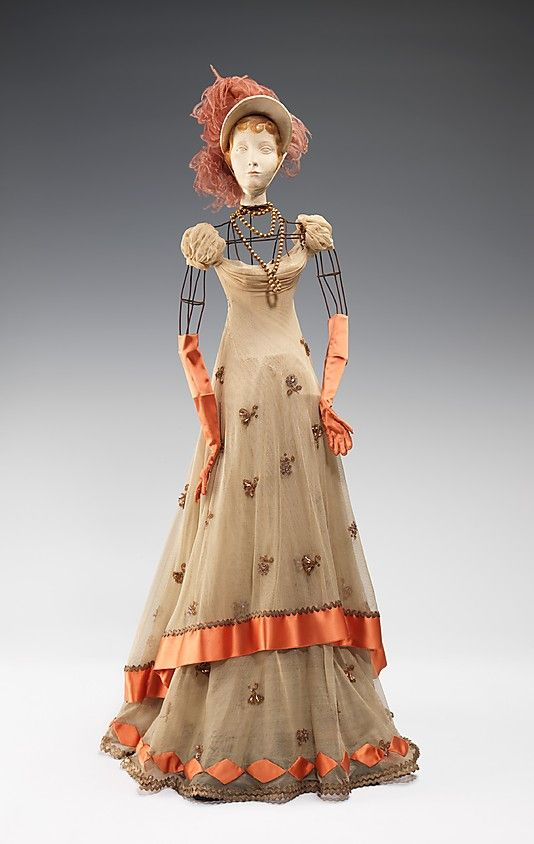 """""""1800 Doll""""  Raphael (Italian)  Designer: Simone Gange Designer: Casale (French) Designer: Fernand Aubry (French) Date: 1949 Culture: French Medium: metal, plaster, hair, silk, metallic, feather Dimensions: 29 x 13 in. (73.7 x 33 cm) Credit Line: Brooklyn Museum Costume Collection at The Metropolitan Museum of Art, Gift of the Brooklyn Museum, 2009; Gift of Syndicat de la Couture de Paris, 1949"""