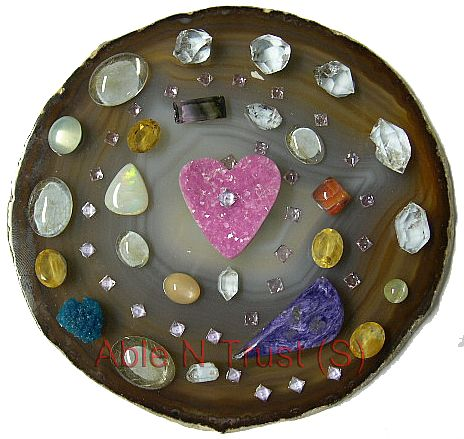 Crystal Mandala is a designed grid work that carries specific energy vortex to meet one's needs. Different type of crystals are used to actualise one's goal, manifesting spirit into matter for personal achievements and transformations. To the Right:  A Mandala for Relationship and Love.