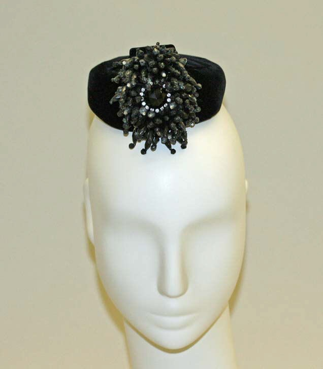Cocktail hat House of Balenciaga  (French, founded 1937) Designer: Cristobal Balenciaga (Spanish, 1895–1972) Date: 1958 Culture: French Medium: cotton, plastic Dimensions: Diameter: 4 1/2 in. (11.4 cm) Credit Line: Gift of Baron Philippe de Rothschild, 1983