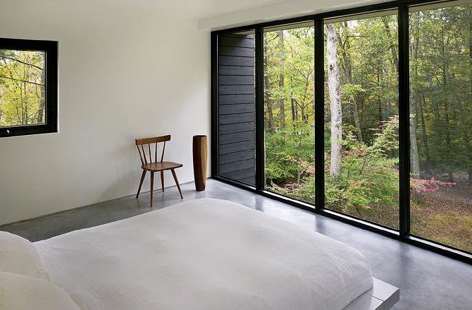 Dormitório no piso superior - concreto polido