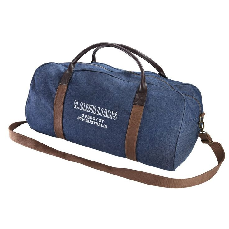 This great looking RM Williams bag is made from heavyweight indigo denim and canvas straps with soft leather handles. Also, features an external side pocket, sturdy zip closure and a detachable shoulder strap.  Finishing off the bag is the RMW print on the side showing the brand and address. Ideal for
