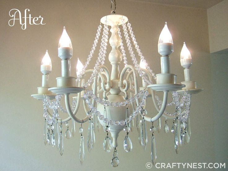 How to give an old chandelier a makeover and make it look better than it did when it was new!  #chandelier #crafts #DIY