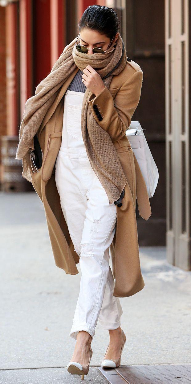 Vanessa Hudgens in white overalls, camel coat, and cap-toe heels