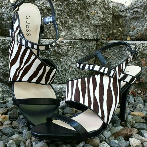 "Guess Sexy Zebra Heels EUC! 4.25"" heel, buckle closure. Cow hair, leather, man made upper, balance man made. Slight wrinkle in the left footbed shown in photo 4. Guess Shoes Heels"