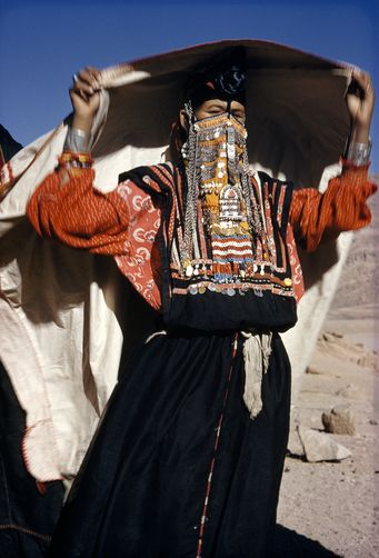 Africa | Gold and silver coins on a Bedouin's veil proclaim her wealth. Mount Sinai, Sinai Peninsula, Egypt | ©Robert Sisson //