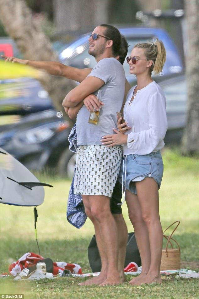 Fun day out: Margot Robbie and Tom Ackerley enjoyed a cute picnic in Hawaii on Tuesday...
