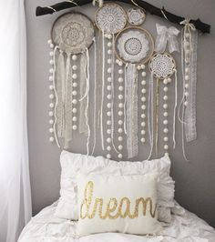 """Jenna on Instagram: """"Skyler and I made some quick doily dream catchers and put them on her pompom branch today. She had fun adding all the lace and different ribbons in, and I love that she did so much work on it. It makes it more hers. She saw a dream catcher wall like this when she was looking at Pinterest and wanted one similar! Dream pillow is from Sarah Kirkland ❤️"""" - Crafting For Ideas"""