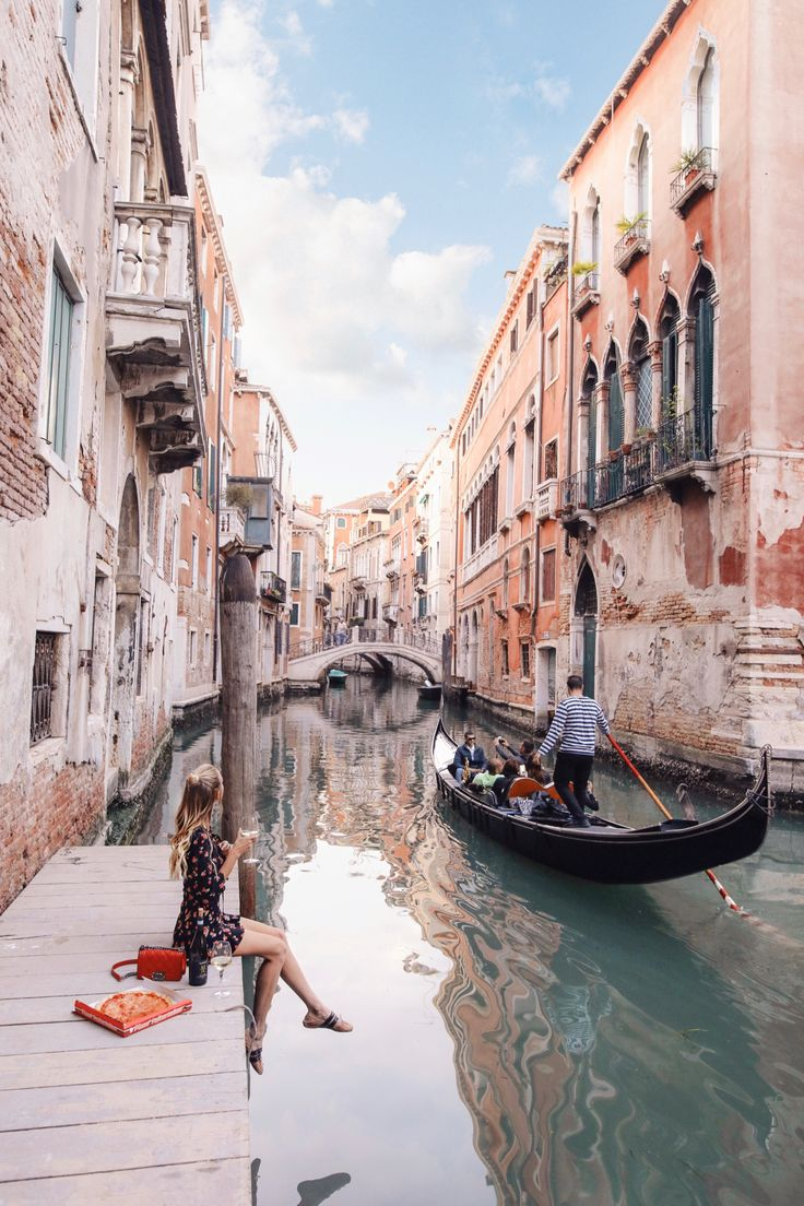Having pizza by a canal in Venice, Italy.