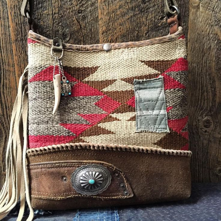 Navajo bucket, fringed side, large sterling and turquoise concho, whip stitch trim on chaps leather base