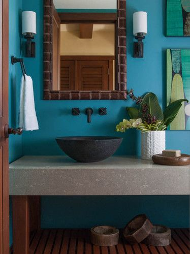 Tropical bathrooms provide a spa-like experience and a tranquil oasis.