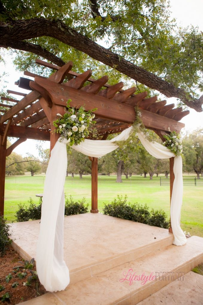 Lifestyle Portrait: Wedding pergola decoration green draping