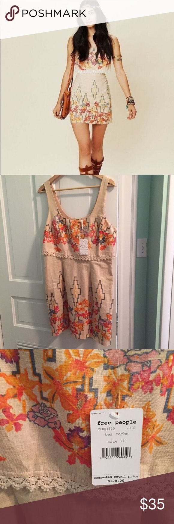 NWT Free People floral crochet mini dress NWT -Gorgeous free people dress. Super flattering. Refer to pic. Slight shimmer to the fabric. Size 10 Free People Dresses Mini