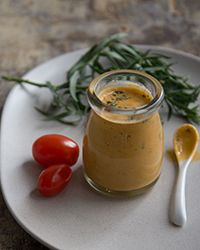 This umami-rich dressing uses extra-virgin olive oil, minced tarragon and red wine vinegar. It is best made with ripe sungold or other sweet cherry or grape tomatoes.