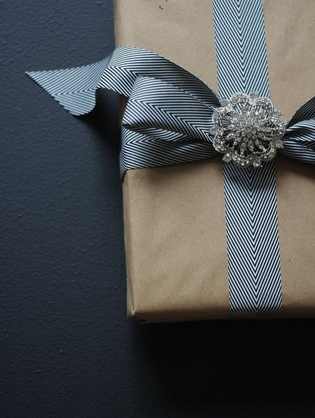 Elegant Gift Wrapping Embellishments       Use herringbone or any type of printed ribbon to enhance the look of a simply wrapped gift.