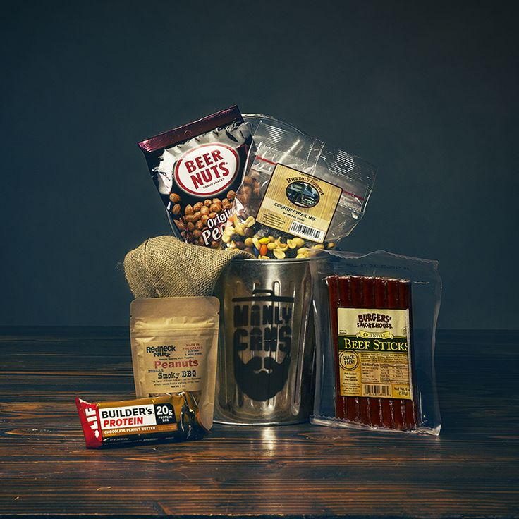 1 GAL | SNACKAGE CAN $35.99  Kicking off our line of Snackage Manly Cans is the 1 Gallon Snackage. A sure way to a man's heart is through his stomach.  Troyer's Country Trail Mix Redneck Nutz Smokey BBQ Peanuts Beer Nuts Burgers' Smokehouse Beef Sticks Peanut Butter Clif Builder Bar