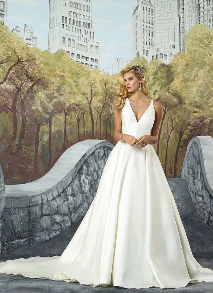 reception information on back of wedding invitation%0A This wedding dress embodies the new clean trend with a structured Mikado  Vneckline  Box pleats create volume and the hand beaded illusion back adds  a