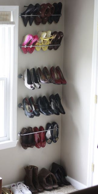 Shoe organization - towel rods, just need to find something to protect the walls
