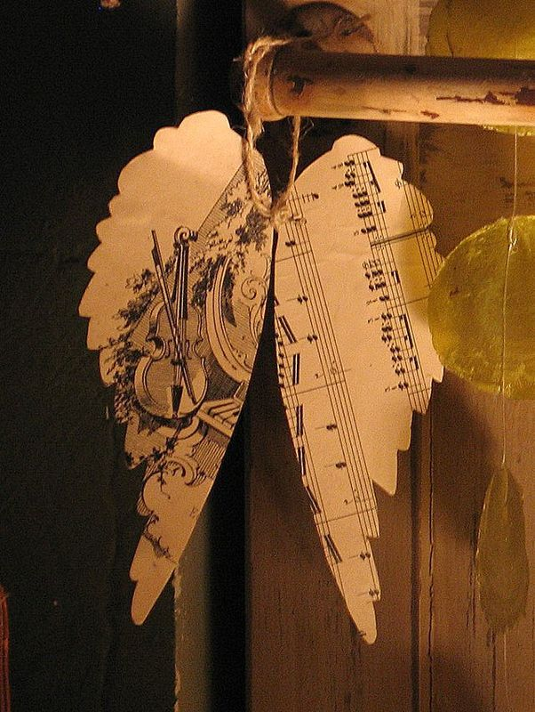 Angel wing Christmas ornaments made from vintage sheet music and twine.