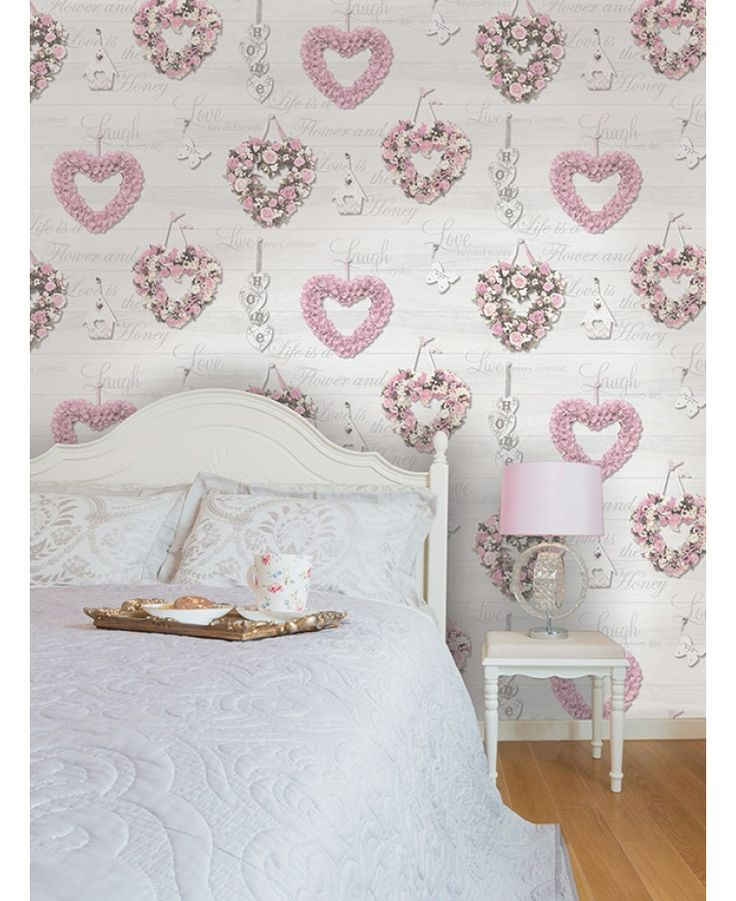 This stunning shabby chic inspired Gracie Hearts wallpaper features beautiful floral heart wreaths in tones of pink and cream on a pale grey wood panel effect background. This is overlaid with inspirational quotes that feature a subtle mica sheen.